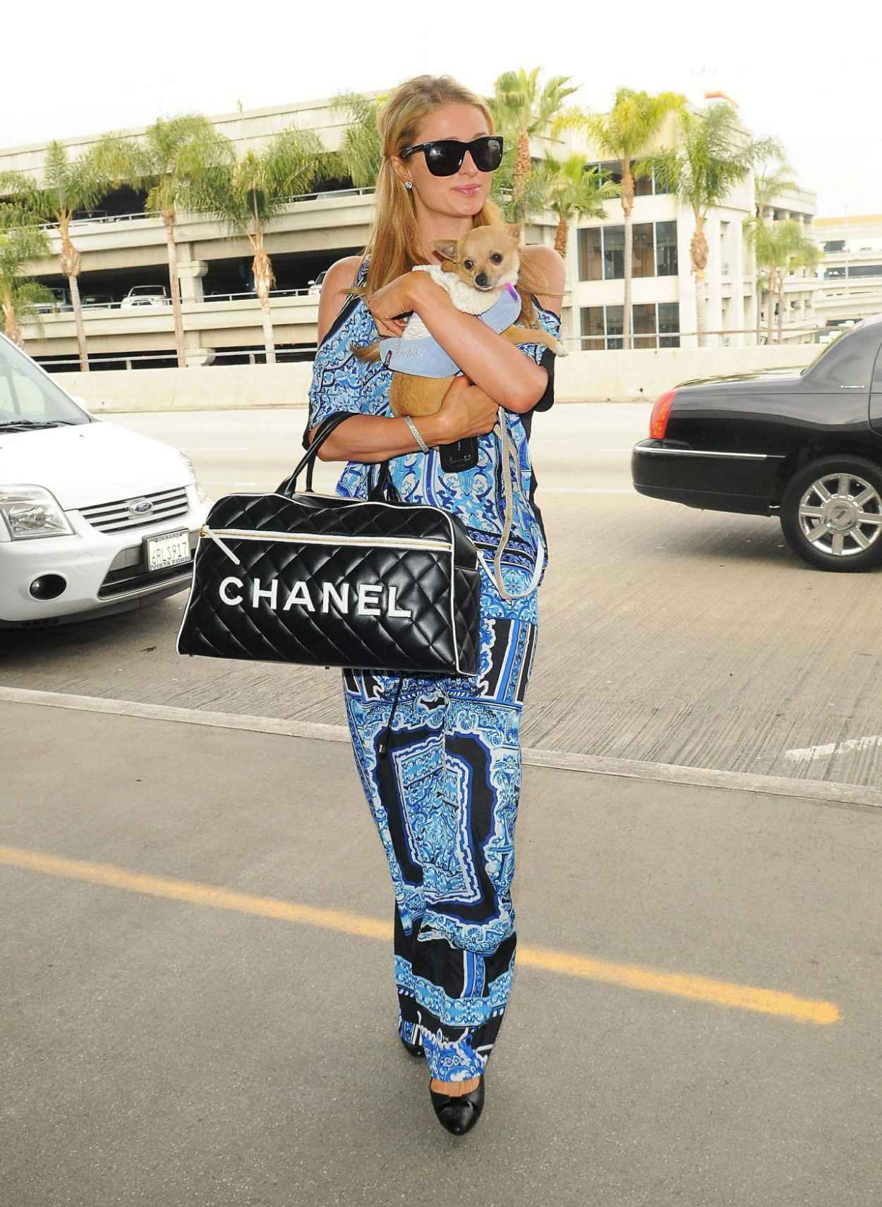 Paris Hilton in a Eye-Catching Outfit - At LAX airport in Los Angeles February 2015-1
