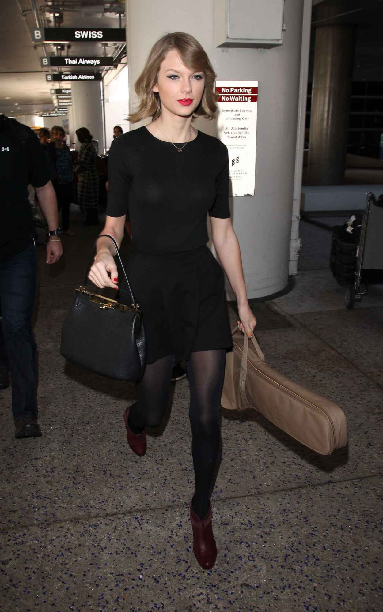 Taylor Swift New Hair Style - LAX Airport - February 2015-1