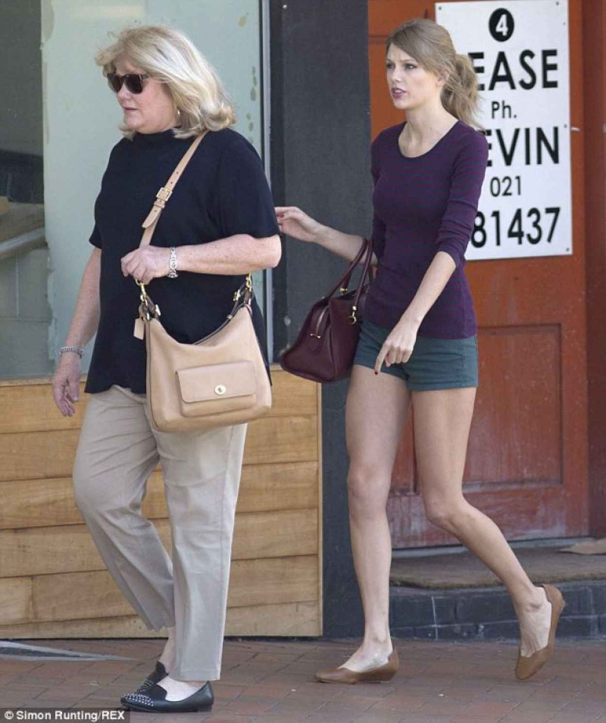 Taylor Swift Shows off Her Legs in Tinny Shorts - Out in Auckland - December 2015-1